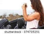 woman tourist taking photo   Shutterstock . vector #374735251