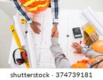contractor and engineer shaking ... | Shutterstock . vector #374739181