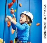 Little Boy Is Climbing To...