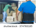man lift heavy carton wearing... | Shutterstock . vector #374783185