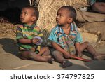 Small photo of Burdwan, India, 30th December, 2014 - Two unidentified nomadic children are staring aimlessly on 30th December in 2014.. They are playing. They are very innocent. They are looking at the destiny.
