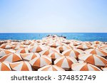 Orange Umbrellas On The Beach ...