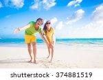 happy young caucasian couple in ... | Shutterstock . vector #374881519