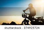 silhouette image of boy riding... | Shutterstock . vector #374925724