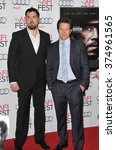 "Small photo of LOS ANGELES, CA - NOVEMBER 12, 2013: Mark Wahlberg (right) with retired Petty Officer 1st Class Marcus Luttrell at the world premiere of his movie ""Lone Survivor"" at the TCL Chinese Theatre, Hollywood"