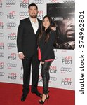 "Small photo of LOS ANGELES, CA - NOVEMBER 12, 2013: Retired Petty Officer 1st Class Marcus Luttrell & wife at the world premiere of the movie based on his story ""Lone Survivor"" at the TCL Chinese Theatre, Hollywood."
