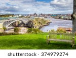 Saint John, New Brunswick, from the Reversing Falls Park with an Empty Wooden Bench in Foreground.