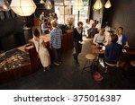Stock photo popular modern coffee shop busy with customers and staff 375016387