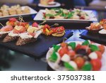 beautifully decorated catering... | Shutterstock . vector #375037381