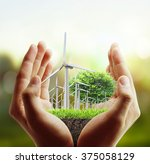 eco power  wind turbines in the ...   Shutterstock . vector #375058129