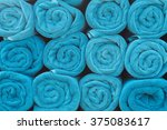 blue rolled towels. | Shutterstock . vector #375083617