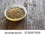 coriander seeds on the dark... | Shutterstock . vector #375097459