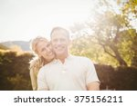 cute couple with arms around... | Shutterstock . vector #375156211