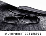 Black And White Eyeglasses With ...