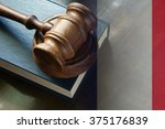 gavel and legal book on wooden