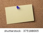 Small photo of Blank adhesive label pinned on bulletin board - horizontal image