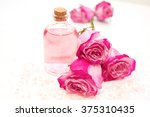 rose essential oil and sea salt | Shutterstock . vector #375310435