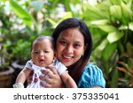 close up mommy and infant with...   Shutterstock . vector #375335041