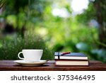 notebook with pencil and cup on ... | Shutterstock . vector #375346495