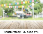 empty wooden table with blurred ... | Shutterstock . vector #375355591
