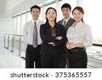 business team looking at camera | Shutterstock . vector #375365557