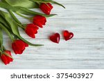 Bouquet Of Red Tulips Lying On...