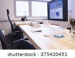 Small photo of Creative web designer desk - Design Agency Interior
