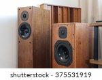 Small photo of Two vintage(old) wood(walnut, teak, cherry) speakers(tallboy, bookshelf) on the listening(audio) room.