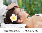beautiful young woman relaxing...   Shutterstock . vector #375557725