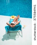Woman In Hat Relaxation At...
