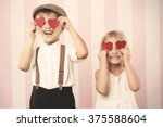 Two Kids With Hearts On The...