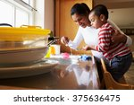 son helping mother to wash... | Shutterstock . vector #375636475