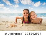 smiling children plays with a... | Shutterstock . vector #375642937