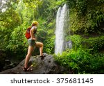 young woman backpacker looking... | Shutterstock . vector #375681145