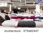 pretty  young woman choosing... | Shutterstock . vector #375682447