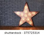 decorative wooden star with old ... | Shutterstock . vector #375725314
