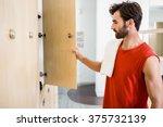 smiling man opening locker in... | Shutterstock . vector #375732139