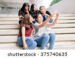 group of happy teen high school ... | Shutterstock . vector #375740635