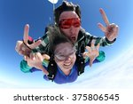 sky diving tandem hands | Shutterstock . vector #375806545