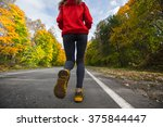 woman running on the asphalt... | Shutterstock . vector #375844447