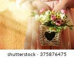 flower girl holding flower | Shutterstock . vector #375876475