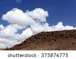 Cumulus Clouds Over Volcanic...