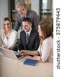 businesspeople having meeting... | Shutterstock . vector #375879445