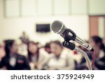 a microphone in empty classroom | Shutterstock . vector #375924949