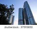 Skyscrapers rising up to the sky in a sunny morning. Wide angle - stock photo
