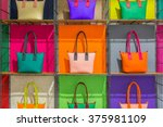 colorful hand bags on shelves | Shutterstock . vector #375981109