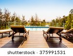 empty chair around swimming... | Shutterstock . vector #375991531