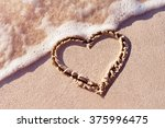 heart handwritten on a sand of... | Shutterstock . vector #375996475