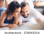 young couple lying in bed ... | Shutterstock . vector #376043314