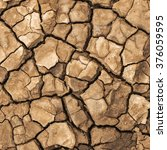 mud on a beach which has dried... | Shutterstock . vector #376059595